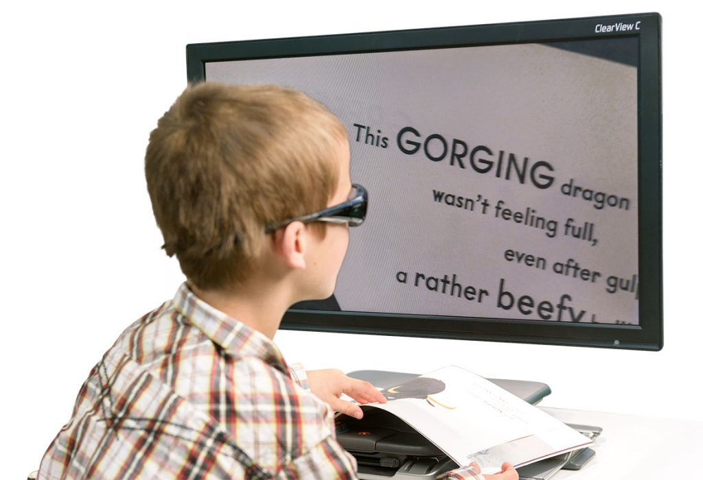 young boy learning with technology